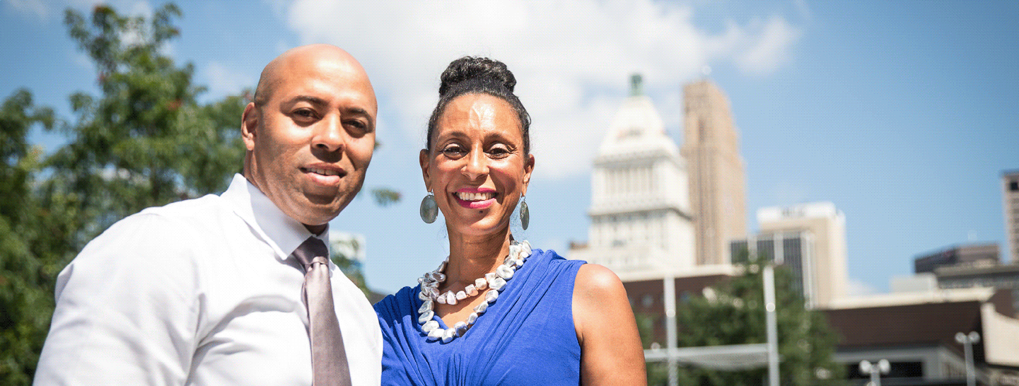 A man and woman standing together smiling in downtown Cincinnati
