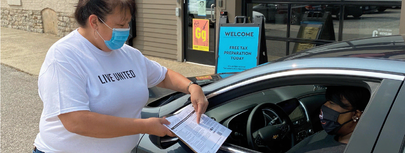 Image of a Free Tax Prep Volunteer assisting a participant