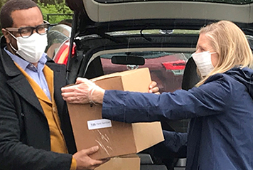 UWGC's CEO Moira Weir distributes PPE masks and supplies during our COVID-19 Relief efforts.