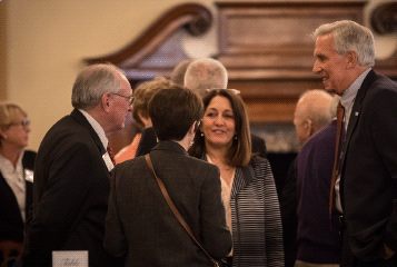 Tocqueville Society: A group of men and women talking at a Tocqueville Society Event