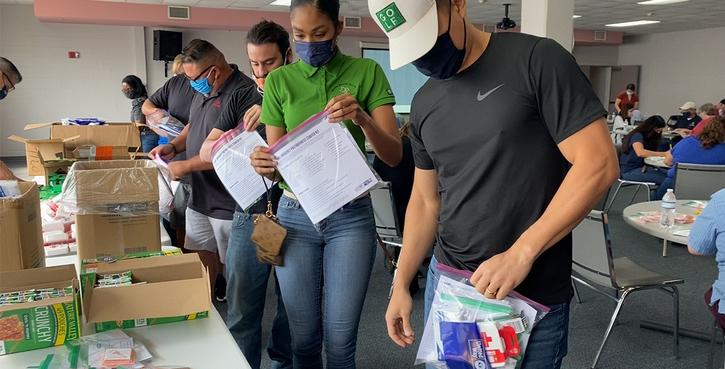 Volunteers packing emergency preparedness kits for local families.