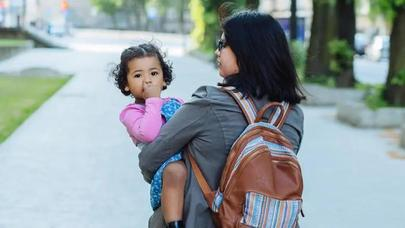 Stock image of mother holding child