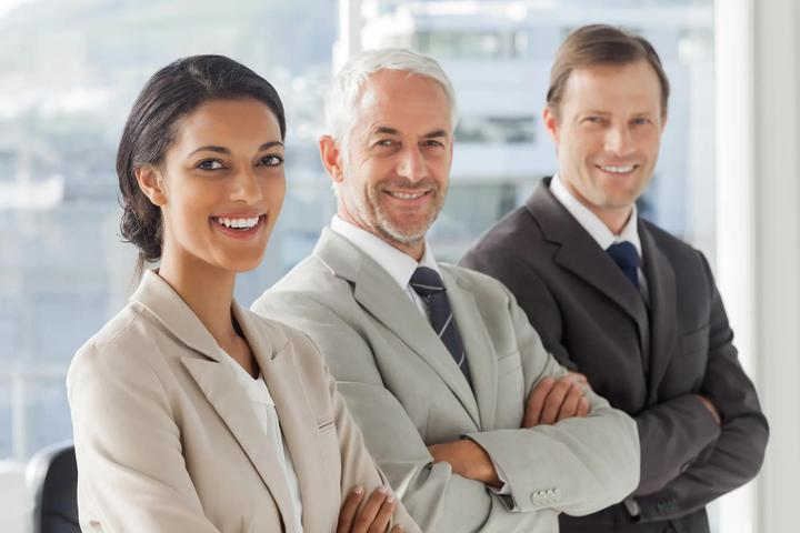 Three business people standing