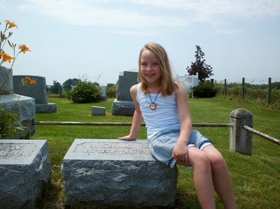 Lola Owens at the grave of her namesake