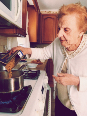 Gram making me poor man's soup. For the sauce we use penne pasta instead of elbows.