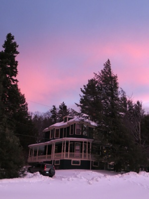 The house during a sunset in the winter.