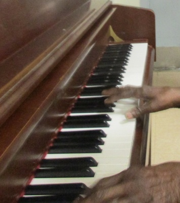 Ms. Delores Weir playing piano