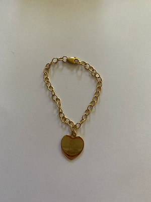 "Gold baby necklace with letter ""C"" on it"