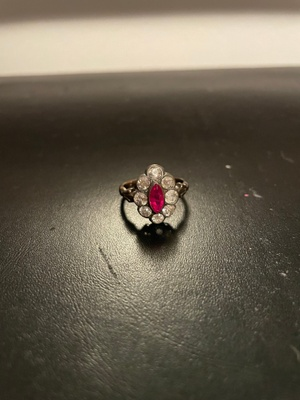 Gold ring with diamonds and ruby.