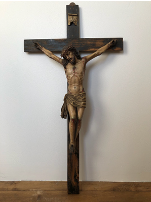 A crucifix carved by my great great grandfather that has been passed down through four generations.