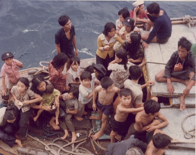 Refugees escape by boat. Wing Luke Museum Collection