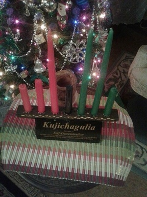 Kinara with red, black & green candles