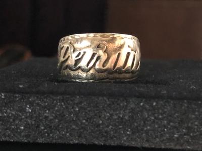 "Grandma's ring with ""Petrita"" on it"