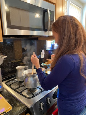 My mom stirring the hot chocolate