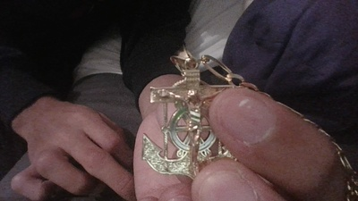its a golden pendant with Jesus