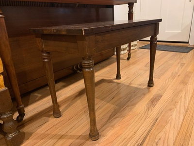 The scratched piano bench.
