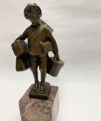 E. Beck Dutch Boy sculpture