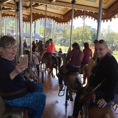 My grandmother and mom on the carousel