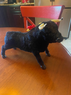 A Spanish bull toy stuffed with cotton.