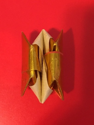 paper dreidel folded as origami toy