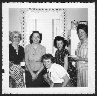 Women in kitchen, 1950s family gathering
