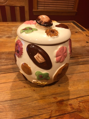 The cookie jar with cookies all over