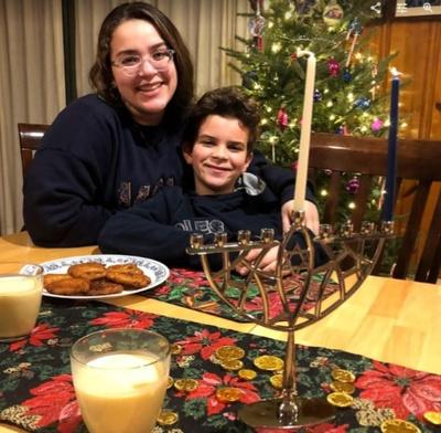 Celebrating Hanukkah with my children.
