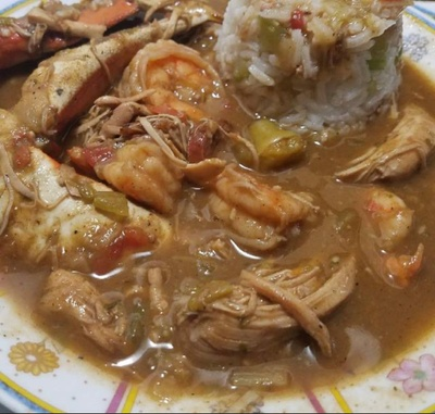Small bowl of soup with seafood