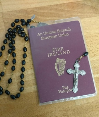 Passport and Rosary Beads