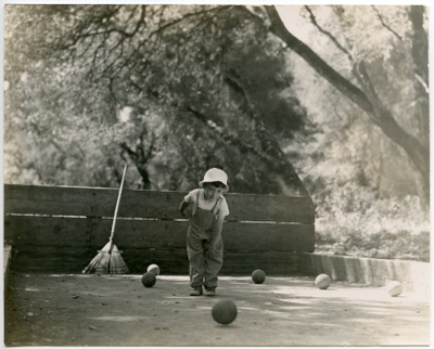 Young Michael playing bocce, c 1952