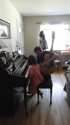 Me playing piano with my dad beside me. (2010)