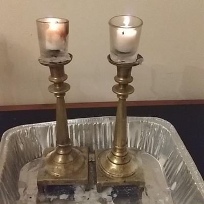 Bronze, tall, and heavy candlesticks