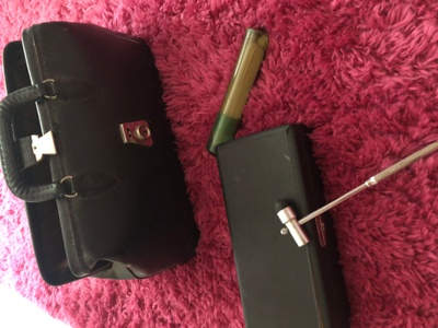 Medical bag, tongue depressors, reflex hammer