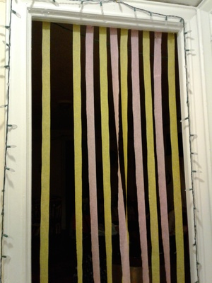 Yellow and pink crepe paper in a doorway
