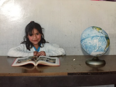 This is a picture of my mom in Mexico him her primary school. This is suppose to be her school picture much different than the high quality ones we take in America.