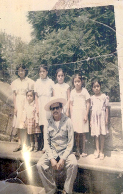 My father, sisters, and me
