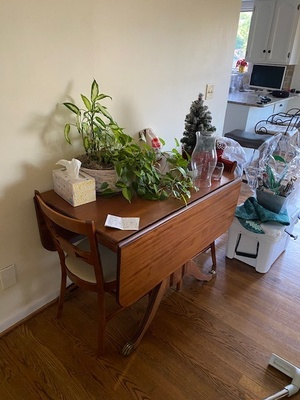 Old dark wooden farm table.