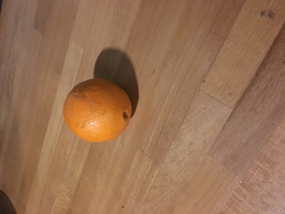 Orange Fruit laying on table