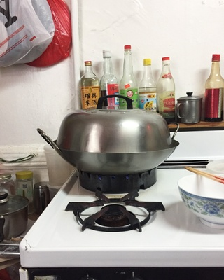 Woks, while typically associated with stir fry dishes, can be used in a variety of ways. For instance, a wok with a lid on top can be used to steam food.
