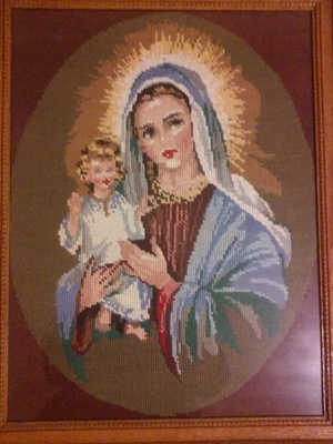An embroidered image of Jesus and Mary.