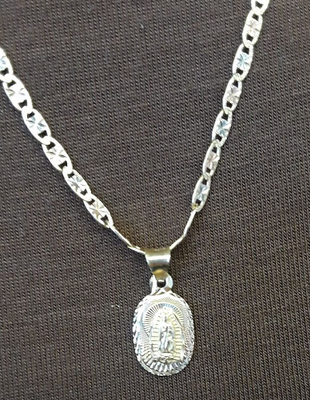 The Necklace is about the Virgin of Altagracia.