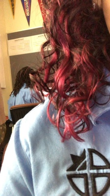 red,short.curly hair.