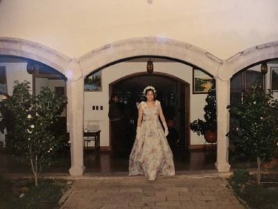 My mother at her quinceanera in Mexico.