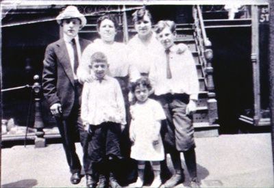 Fannie Rogarshevsky, second from left, with some of her family outside of 97 Orchard Street.
