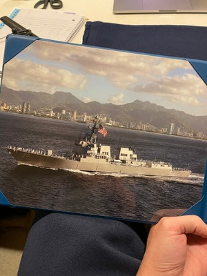 CHAFEE sailing past Honolulu with the battle flag hoisted, a tradition when returning home from sea.