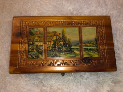 Medium sized wooden box with painting.