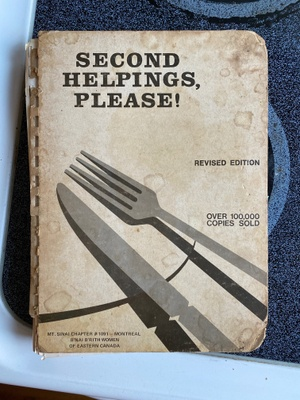 Cookbook cover. Faded, tattered edges.