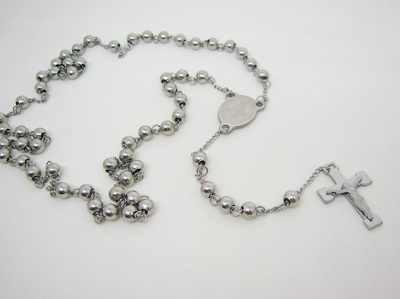 This rosary is gray, and it has a cross.