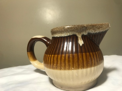 A coffee mug made out of red clay