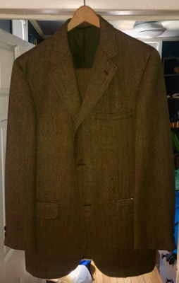 The Jacket. The cloth is brown wool tweed with yellow, red, and green threads running through it.